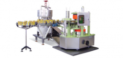 Machine for lids sealing on metal cans